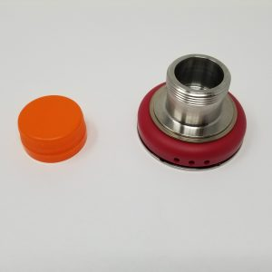 An orange bottle cap and a chuck