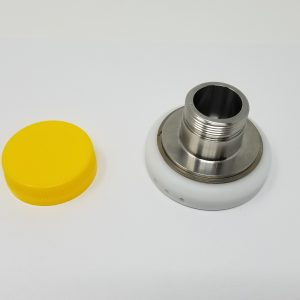 A yellow bottle cap and a chuck